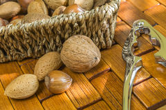 Almonds, hazelnuts, walnuts and nut cracker Royalty Free Stock Images