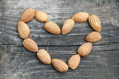 Almonds heart on wood Stock Image