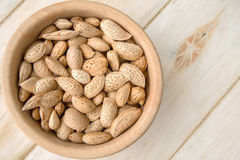 Almonds. Heart In A Wooden Bowl Royalty Free Stock Photo