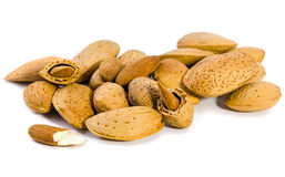 Almonds inshell. A large number of almond nuts closeup on white background stock photo