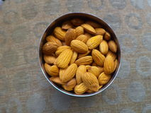 Almonds. Inside a steel container Royalty Free Stock Images