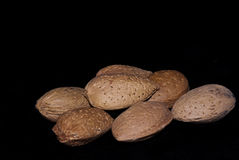 Almonds isolated on a black Royalty Free Stock Photos