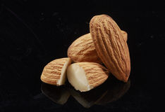 Almonds isolated on the black background. Group of almonds isolated on the black background Stock Photos