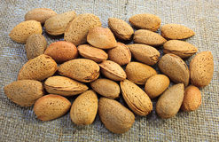 Almonds on jute surface Royalty Free Stock Images