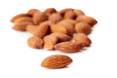 Almonds kernel. Close up of almonds kernel isolated on white background royalty free stock photography