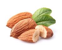 Almonds kernel with leaves. On a white background royalty free stock images