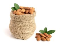Almonds with leaf in bag from sacking isolated on white background.  Royalty Free Stock Photography