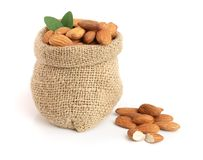 Almonds with leaf in bag from sacking isolated on white background.  Royalty Free Stock Photo