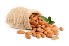 Almonds with leaf in bag from sacking isolated on white background.  royalty free stock photos