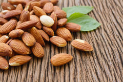 Almonds  with leaf on wooden backgroun Royalty Free Stock Photo