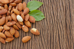 Almonds  with leaf on wooden background Stock Photo