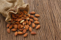 Almonds  with leaf on wooden background Royalty Free Stock Images