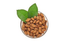 Almonds with leaves. Isolated on white Royalty Free Stock Photo