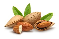 Almonds with leaves. Isolated on white background royalty free stock image