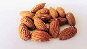 Almonds on a light background. Almonds on the light background. Healthy food stock photo