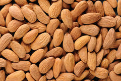 Almonds macro background Stock Photo