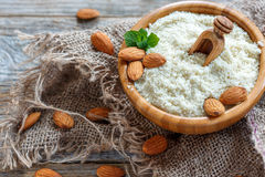 Almonds, mint and almond flour in a wooden bowl. Royalty Free Stock Photo