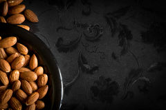 almonds nut in black plate on dark background Stock Photography
