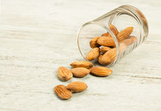 Almonds nut in cup. Almonds nut in cup on wood table Royalty Free Stock Photography