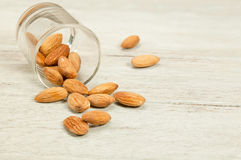 Almonds nut in cup. Almonds nut in cup on wood table Stock Photo