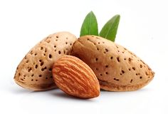 Almonds nuts . Almonds nuts with leaves on white backgrounds Stock Photography