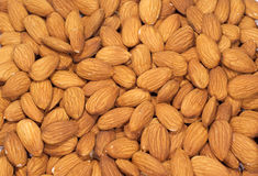 Almonds nuts as a background. Many Almonds as a background Stock Images