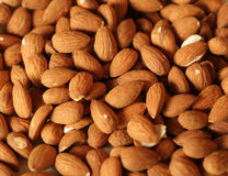 Almonds nuts background Stock Images