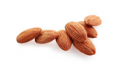Almonds nuts. Glass bowl with almonds nuts isolated on white background royalty free stock image