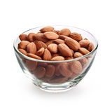 Almonds nuts. Glass bowl with almonds nuts isolated on white background royalty free stock images