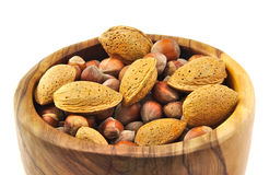 Almonds and nuts in a handmade wooden bowl Royalty Free Stock Photography