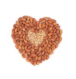Almonds nuts in heart shape. Royalty Free Stock Photography