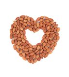 Almonds nuts in heart shape. Stock Photos