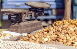 Almonds and nuts. Next to an old balance royalty free stock image