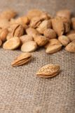 Almonds nuts on sackcloth Royalty Free Stock Images
