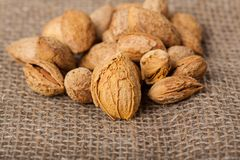 Almonds nuts on sackcloth Royalty Free Stock Photo