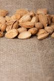 Almonds nuts on sackcloth Stock Photo
