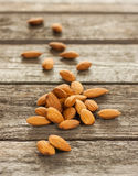 Almonds on an old vintage planked wood table Royalty Free Stock Photography