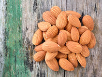 Almonds on old wood background Royalty Free Stock Image
