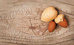 Almonds on old wood background Royalty Free Stock Photo