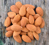 Almonds on old wood background Stock Image