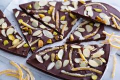 Almonds, orange peel and salt chocolate bark Stock Images