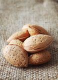Almonds over rustic background Royalty Free Stock Images