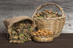 Almonds over rustic wooden board. Royalty Free Stock Photos