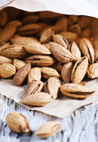 Almonds in the paper bag Stock Images
