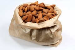 Almonds in the paper bag Royalty Free Stock Images