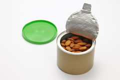 Almonds peeled in a canister Royalty Free Stock Image