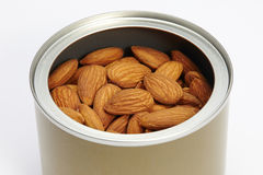 Almonds peeled in a canister Royalty Free Stock Photography