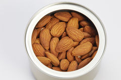 Almonds peeled in canister Stock Photos