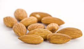 Almonds in pile on white background Royalty Free Stock Photography