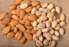 Almonds & Pistachio. Almonds and Pistachio on sack background Stock Images